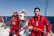 SPAIN, Alicante. 20th October 2011. On board Team Sanya practice session. Skipper Mike Sanderson (right), and Watch Leader Cameron Dunn.