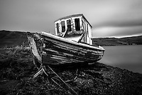 SCOTLAND - CIRCA APRIL 2016: Abandoned boat over Loch Harport near Carbost in Skye an Island in Scotland