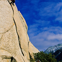 Rock climber climbing the classic off-width crack, 5.10d, Little Cottonwood Canyon, Utah