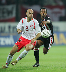 WARSAW, POLAND - WEDNESDAY, SEPTEMBER 7th, 2005: Wales' Robert Earnshaw and Poland's Mariusz Jop during the World Cup Group Six Qualifying match at the Legia Stadium. (Pic by David Rawcliffe/Propaganda)