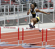 One of two Meadowdale Lions competes in the Girls 300 Meter Hurdles during the Buff Taylor Memorial Track & Field Invitational at the Good Samaritan Sports Plex at Trotwood Madison High School, Saturday, May 10, 2008.
