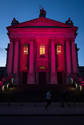 © Licensed to London News Pictures. 08/03/2018. LONDON, UK.  Tate Modern and Tate Britain (pictured) are lit up in a magenta colour to mark International Women's Day.  The colour was chosen by the HeForShe UN Women's solidarity campaign encouraging all genders to stand for gender equality.  Photo credit: Stephen Chung/LNP