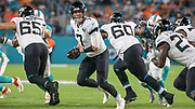 Aug 22, 2019; Miami Gardens, FL USA;  Jacksonville Jaguars quarterback Nick Foles (7) hands the ball off to  running back Leonard Fournette (27)during an NFL preseason game at Hard Rock Stadium. The Dolphins beat the Jaguars 22-7. (Kim Hukari/Image of Sport)