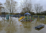 © Licensed to London News Pictures. 26/11/2012. Oxfordshire, UK A children's play park submerged by floodwater in Osney. Flooding on the River Thames today 26th November 2012 in Oxfordshire. Photo credit : Stephen Simpson/LNP