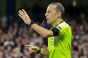 Referee Cuneyt Cakir signals towards the penalty spot after a VAR hand-ball decision during the Champions League match between Chelsea and Valencia CF at Stamford Bridge, London, England on 17 September 2019.