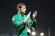 Alfreton Town goalkeeper Fabian Speiss applauds the away fans after the The FA Cup match between Newport County and Alfreton Town at Rodney Parade, Newport, Wales on 15 November 2016. Photo by Andrew Lewis.
