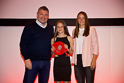 NEWPORT, WALES - Saturday, May 19, 2018: Libby Isaac is presented with her Under-16's cap by Osian Roberts (left) and Lauren Dykes (right) during the Football Association of Wales Under-16's Caps Presentation at the Celtic Manor Resort. (Pic by David Rawcliffe/Propaganda)