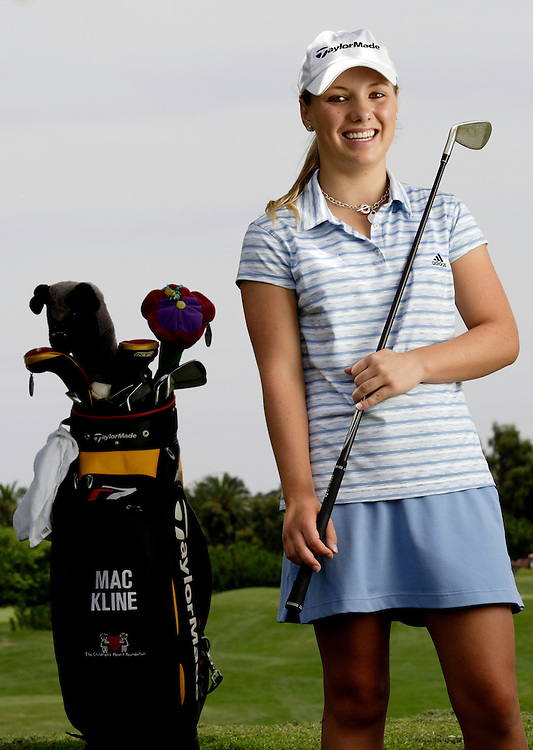 MacKenzie Kline suffers from a bad heart after being born with only one ventricle. She does not receive enough oxygen and is fatigued quickly. She battled the United States Golf Association to allow her use of a cart and her oxygen during competition. After initially being denied, the USGA allowed her to use both. She was good enough to gain entry into the U.S. Girls' Junior and the U.S. Women's Amateur championships. She was photographed at her home course Encinitas Ranch in Encinitas, CA on August 1, 2006  (Photograph by Todd Bigelow/Aurora).