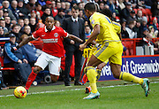 Charlton Athletic midfielder Callum Harriott makes himself look bigger to try and block the clearance from Nottingham Forest defender Michael Mancienne  during the Sky Bet Championship match between Charlton Athletic and Nottingham Forest at The Valley, London, England on 2 January 2016. Photo by Andy Walter.