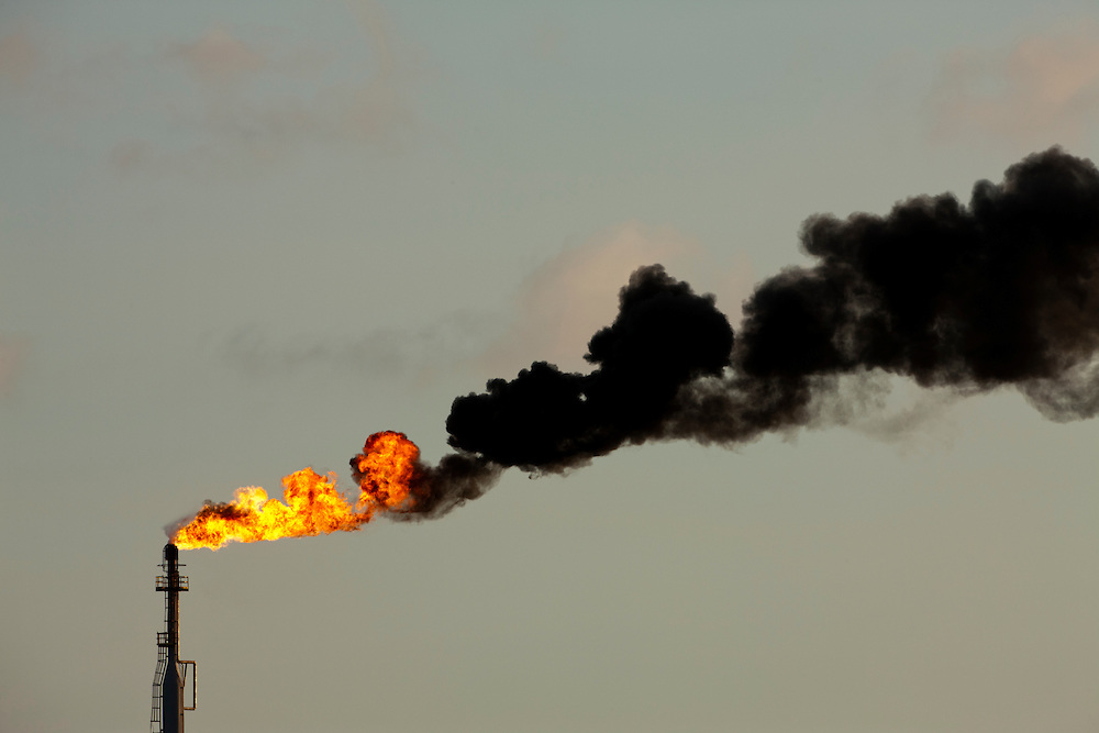 Dutch Antilles, Aruba, Flames and smoke billow from natural gas flare at Valero Oil Refinery
