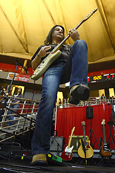 29 December 2011:  Kirk Ellis, guitarist, fiddle player. The BrusfhFire Band performed during an NCAA mens basketball game between the Northern Illinois Panthers and the Illinois State Redbirds in Redbird Arena, Normal IL