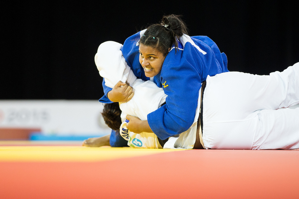 Maria Suelen Altheman of Brazil pins Leidi German of the Dominican Republic to win the bronze medal in the women's judo +78kg class at the 2015 Pan American Games in Toronto, Canada, July 14,  2015.  AFP PHOTO/GEOFF ROBINS