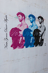 "© Licensed to London News Pictures. 29/12/2016. LONDON, UK.  New George Michael street art by Pegasus in Shoreditch, east London. The artwork shows three Faith-era images of the singer, who was found dead in his bed on Christmas Day, with a quote from anthem Careless Whisper, saying: ""Never Gonna Dance Again"".  US born street artist Pegasus, who became well known after his image of Meghan Markle created the new artwork in London yesterday, saying that he wanted to pay tribute to George Michael because of the inspiration he had been given by him. Photo credit: Vickie Flores/LNP"