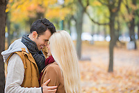 Loving couple hugging in park