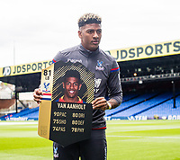 LONDON, ENGLAND - MAY 13: Patrick van Aanholt (3) of Crystal Palace with EA FIFA card  before the Premier League match between Crystal Palace and West Bromwich Albion at Selhurst Park on May 13, 2018 in London, England. MB Media