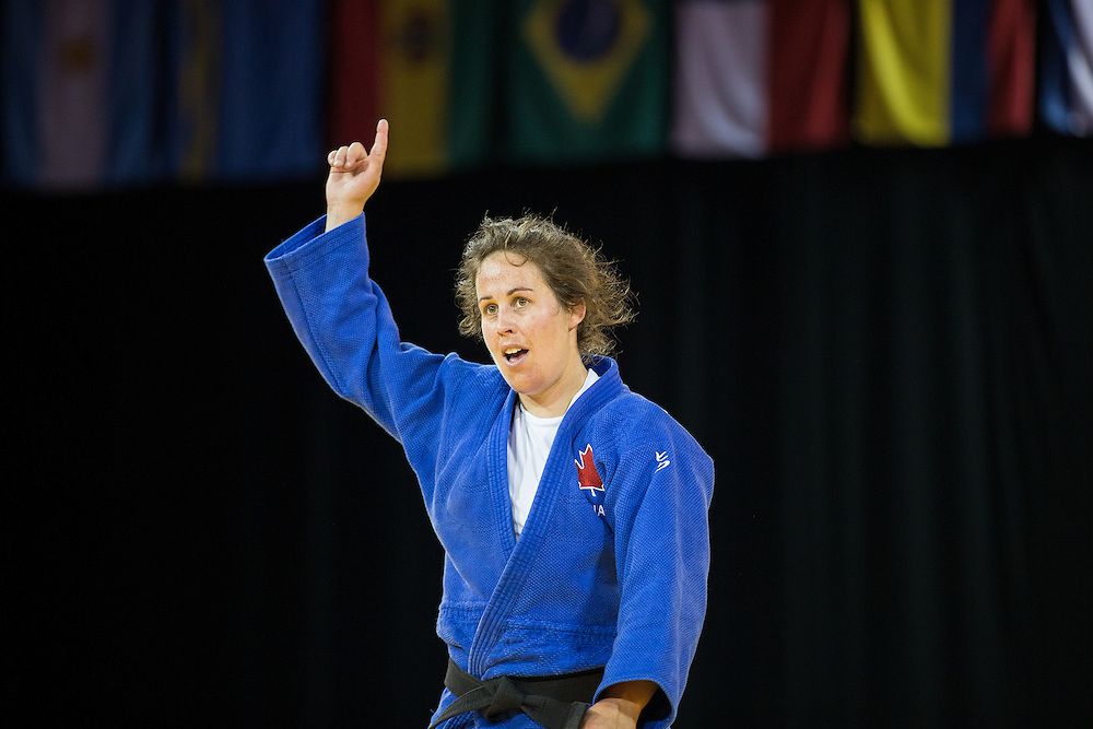 Catherine Roberge (R) of Canada celebrates after defeating Jacqueline Usnayo to win the bronze medal in the women's judo -78kg class at the 2015 Pan American Games in Toronto, Canada, July 14,  2015.  AFP PHOTO/GEOFF ROBINS