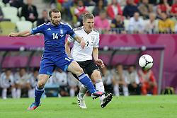 22.06.2012, Arena Gdansk, Danzig, POL, UEFA EURO 2012, Deutschland vs Griechenland, Viertelfinale, im Bild DIMITRIS SALPINGIDIS (GRE) BASTIAN SCHWEINSTEIGER (GER) // during the UEFA Euro 2012 Quarter Final Match between Germany and Greece at the Arena Gdansk, Gdansk, Poland on 2012/06/22. EXPA Pictures © 2012, PhotoCredit: EXPA/ Newspix/ Maciej Opala..***** ATTENTION - for AUT, SLO, CRO, SRB, SUI and SWE only *****