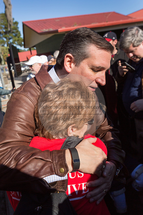 U.S. Senator and GOP presidential candidate Ted Cruz hugs a supporter during a campaign event at Ottawa Farms December 19, 2015 in Bloomingdale, Georgia.