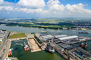 Nederland, Zuid-Holland, Rotterdam, 10-06-2015; Botlek, 2e Werkhaven met Dok 7, het mammoetdok van werf van Keppel Verolme. Aan het water van rivier Het Scheur (verlengde Nieuwe Waterweg) de pakhuizen van Steinweg Handelsveem<br /> Botlek, 2nd Werkhaven with Dock 7, the mammoth dock at the yard Keppel Verolme. Neigbouring the water of the river Scheur (extended New Waterway) the warehouses of Steinweg stevedoring.<br /> <br /> luchtfoto (toeslag op standard tarieven);<br /> aerial photo (additional fee required);<br /> copyright foto/photo Siebe Swart