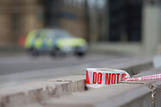 Police tape blocks Westminster Bridge as Westminster experiences a lockdown with extensive cordons and the closure of many streets after what police are calling a terrorist incident in which a car was crashed into security barriers outside parliament in central London, on 14th August 2018, in London, England.