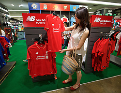 BANGKOK, THAILAND - Sunday, July 12, 2015: A shopper looks at the new Liverpool FC New Balance home shirt at Central World shopping mall ahead of the team's arrival in Thailand for the start of the club's preseason tour. (Pic by David Rawcliffe/Propaganda)