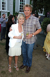 LULU and GORDON RAMSAY at a party to celebrate FilmFour becoming the UK's first major free film channel held at Debenham House, Addison Road, London on 20th July 2006.<br />