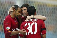 Roma 22/2/2004 <br />Roma Siena 6-0 <br />Marco Delvecchio festeggiato da Emerson e Amantino Mancini dopo il gol del 5 a 0 per la Roma<br />Photo Andrea Staccioli Graffiti