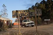 A graffiti in a road sign marks the entering of the territory protected by the Community Police.  / Un grafitti marca la entrada al territorio protegido por la Policía Comunitaria.  (Photo:  Prometeo Lucero)