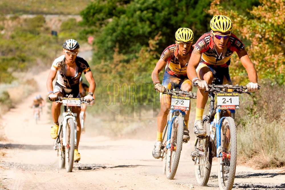 GREYTON, SOUTH AFRICA - Kevin Evans, David George and Emil Lindgren chase the leaders during stage five , 5 , of the Absa Cape Epic Mountain Bike Stage Race held between Greyton and Oak Valley ( Elgin / Grabouw ) on the 26 March 2009 in the Western Cape, South Africa..Photo by Nick Muzik  /SPORTZPICS
