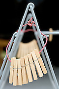 wooden cloth pegs on a standing clothing drying rack