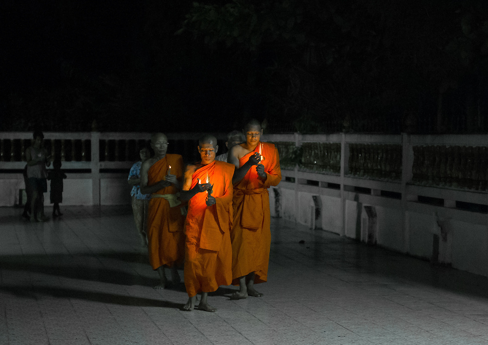 Monks lead a candlelight procession during Visakha Puja Day in rural Nakhon Nayok, Thailand. PHOTO BY LEE CRAKER