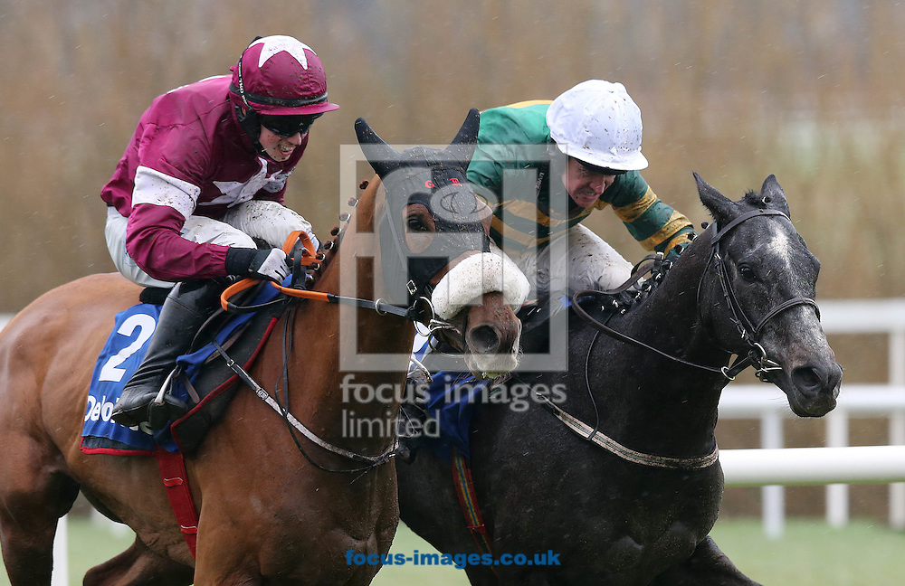 Barry Geraghty on Bleu et Rouge (on inside) wins the Deloitte Novice Hurdle from Bryan Cooper on Tombstone during the Irish Gold Cup meeting at Leopardstown Racecourse, Eire.<br /> Picture by Lorraine O'Sullivan/Focus Images Ltd +353 872341584<br /> 06/02/2016