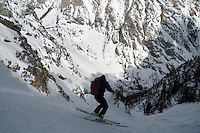 A skier enters Turkey Chute on the back side of Twenty-five Short in Grand Teton National Park.