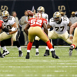 August 12, 2011; New Orleans, LA, USA; New Orleans Saints center Olin Kreutz (50) and guard Carl Nicks (77) work against San Francisco 49ers defenders defensive tackle Ricky Jean-Francois (95). linebacker Patrick Willis (52) and defensive tackle Justin Smith (94) during the first half of a preseason game at the Louisiana Superdome. Mandatory Credit: Derick E. Hingle