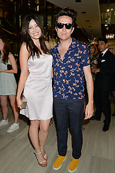 DAISY LOWE and NICK GRIMSHAW at the Watches of Switzerland Flagship Store Launch, 155 Regent Street, London on 17th July 2014.