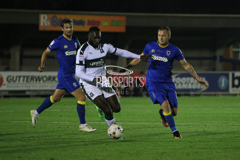AFC Wimbledon midfielder Dean Parrett (18) and Plymouth Argyle striker David Ijaha (22) during the EFL Trophy match between AFC Wimbledon and Plymouth Argyle at the Cherry Red Records Stadium, Kingston, England on 4 October 2016. Photo by Stuart Butcher.