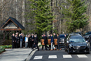 Pallbearers carry the casket of Rev. Billy Graham passed family members as it arrives at the Billy Graham Library in Charlotte. N.C.on Saturday, Feb. 24, 2018. (AP Photo/Kathy Kmonicek)