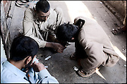 "A small drug community spends his time in the landing of a building to consume hashish and heroin. One of them (left) belongs from the middle class. Shan Nazar Kapull, Rawalpindi, Pakistan, on thursday, November 27 2008.....""Pakistan is one of the countries hardest hits by the narcotics abuse into the world, during the last years it is facing a dramatic crisis as it regards the heroin consumption. The Unodc (United Nations Office on Drugs and Crime) has reported a conspicuous decline in heroin production in Southeast Asia, while damage to a big expansion in Southwest Asia. Pakistan falls under the Golden Crescent, which is one of the two major illicit opium producing centres in Asia, situated in the mountain area at the borderline between Iran, Afghanistan and Pakistan itself. .During the last 20 years drug trafficking is flourishing in the Country. It is the key transit point for Afghan drugs, including heroin, opium, morphine, and hashish, bound for Western countries, the Arab states of the Persian Gulf and Africa..Hashish and heroin seem to be the preferred drugs prevalence among males in the age bracket of 15-45 years, women comprise only 3%. More then 5% of whole country's population (constituted by around 170 milion individuals),  are regular heroin users, this abuse is conspicuous as more of an urban phenomenon. The substance is usually smoked or the smoke is inhaled, while small number of injection cases have begun to emerge in some few areas..Statistics say, drug addicts have six years of education. Heroin has been identified as the drug predominantly responsible for creating unrest in the society."""