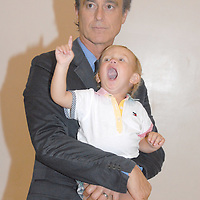Santa Monica Mayor Bobby Shriver holds his daughter Rosemary, 18 mo., during the National Center on Addiction Substance Abuse's (CASA) Family Day - A Day to Eat Dinner with Your Children(TM) at the Santa Monica YMCA on Tuesday, September, 28, 2010