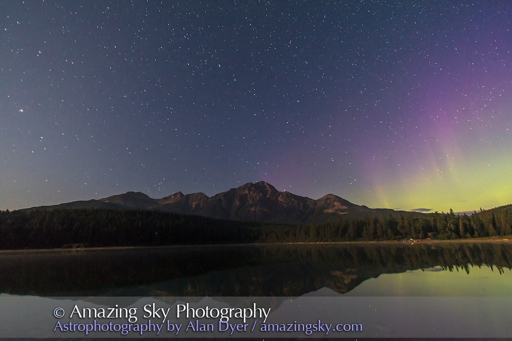 The Big Dipper over Pyramid Mountain and Patricia Lake in Jasper National Park, Alberta. Taken July 28, 2012 with Canon 7D and 10-22mm lens for 45s at f/4 and ISO 800. Moonlight from waxing gibbous Moon (off camera) provides the illumination. An aurora peaks in activity for the night at right to the northeast. Jasper is a Dark Sky Preserve.