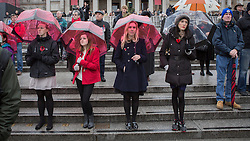 © Licensed to London News Pictures. 11/11/2013. Members of the public observe a 2 minute silence today in Trafalgar Square as part of the sixth annual Silence in the Square.  The Royal British Legion organise the service to commemorate Armistice Day and join the nation in observing a 2 minute silence.    Photo credit: Alison Baskerville/LNP