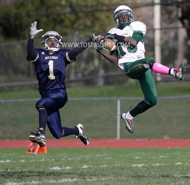 Beacon, New York - Ivan Bozier, right, of Woodlands leaps to catch a pass as Beacon's Jerel Galloway defends during a high school football game on Oct. 16, 2010. ©Tom Bushey / The Image Works