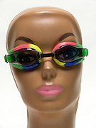 funny portrait of a mannequin head with goggles