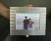 Joshua Fidler, now 20, holds a photograph of him with his brother Jacob, 17, from six years ago.