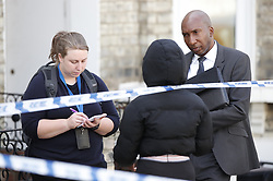 © Licensed to London News Pictures. 15/08/2019. London, UK. Detectives talk to a witness in Corrance Road in south London where a murder investigation has been launched after an 18-year-old man was found with fatal stab injuries. A 17-year-old boy was arrested on suspicion of murder at 14. 23hrs in Tremadoc Road. He has been taken into custody. Photo credit: Peter Macdiarmid/LNP