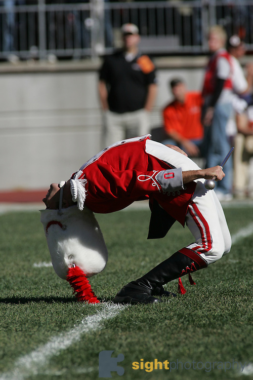 COLUMBUS, OH - OCTOBER 07: Stew Kitchen, Drum Major of The Ohio State Buckeyes Marching Band does a backbend before the start of the game with the Bowling Green Falcons on October 7, 2006 at Ohio  Stadium in Columbus, Ohio. .Credit: Bryan Rinnert<br />