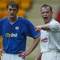 St Johnstone v Falkirk...03.04.04<br />Yogi Hughes shoyts instructions watched by Ian Maxwell<br /><br />Picture by Graeme Hart.<br />Copyright Perthshire Picture Agency<br />Tel: 01738 623350  Mobile: 07990 594431