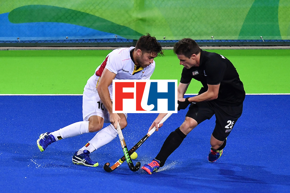 Belgium's Cedric Charlier (L) and New Zealand's Shea Mcaleese vie during the mens's field hockey Belgium vs New Zealand match of the Rio 2016 Olympics Games at the Olympic Hockey Centre in Rio de Janeiro on August, 12 2016. / AFP / MANAN VATSYAYANA        (Photo credit should read MANAN VATSYAYANA/AFP/Getty Images)