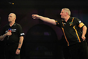 Wayne Jones and caller Russ Bray during the World Championship Darts 2018 at Alexandra Palace, London, United Kingdom on 17 December 2018.