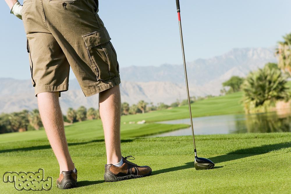Man Holding Golf Club on Putting Green